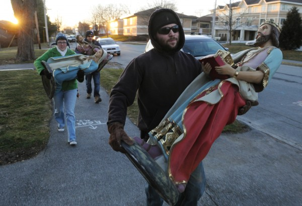 Ian McDonald (foreground) and his wife, Sara, followed closely by Justin Vroom, carry pieces of a Nativity scence down York Street in Bangor on Sunday, Dec. 18, 2011. The three are part of a under 35 singles group called CAFE — Catholic Adult Faith Enrichment — which helped move the items into the church from storage to ready the Nativity for Christmas.