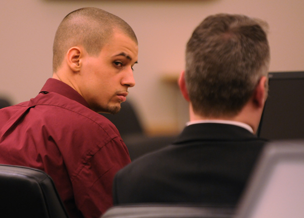 Zachary Carr sits with his attorney in court during his sentencing Friday, Dec. 2, 2011. Carr received 35 years in the shooting death of John &quotBobby&quot Surles.