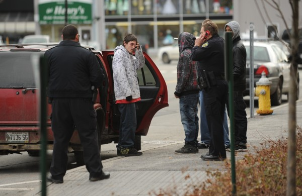 Bangor police remove a handgun from a vehicle after a youth dispalyed an empty holster and made threats to other youths outside the Penobscot County Judicial Center in Bangor on Friday, Dec. 2, 2011, after Zachary Carr was sentenced to 35 years in prison in the shoting death of John &quotBobby&quot Surles.