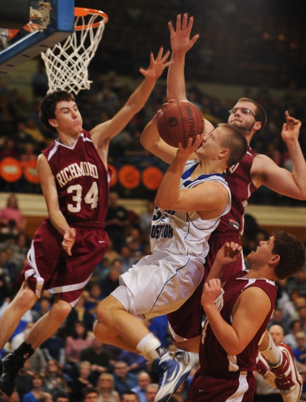 Central Aroostook's Brendan York puts up a shot against Richmond's Nate Tibbetts and Kyle O'Brien during last season's Class D state final. York, a four-year starter, returns to help CAHS defend its title when the high school basketball season opens this weekend.