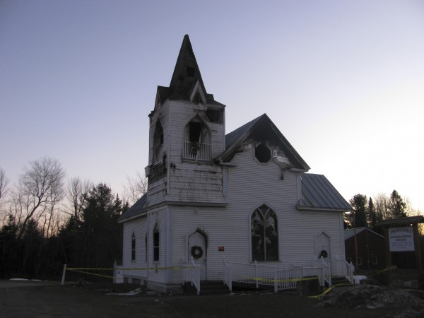 The burned-out Thorndike Congregational Church was blocked by yellow police tape Thursday. Fire investigators determined that the fire early Wednesday morning was caused by an electrical malfunction.