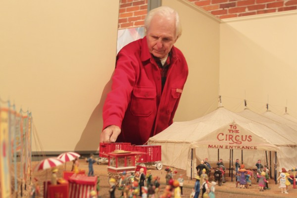Les Bex, 74, of Camden, former owner of the Maine Windjammer Cruises, arranges one of his circus canvas wagons on Tuesday at the Penobscot Marine Museum Main Street Gallery in Searsport in preparation for &quotThe Circus Comes to Town,&quot an exhibit running through Jan. 29 that is featuring his model circus.