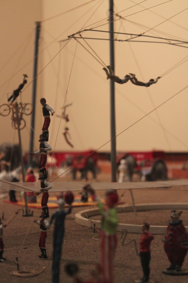 Trapeze artists fly and clowns entertain spectators at the Bex Bros. Circus, a model circus build by Les Bex of Camden that is on display at the Penobscot Marine.