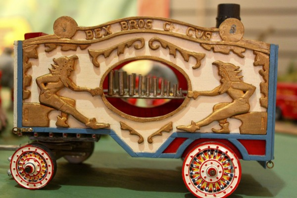 Two gold jesters adorn the steam calliope that Les Bex of Camden built for his Bex Bros. Circus. The golden letters along the top of the calliope are alphabet soup.
