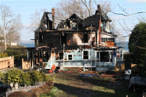 The back of a house where an early morning fire left five people dead is seen Sunday, Dec. 25, 2011, in Stamford, Conn.