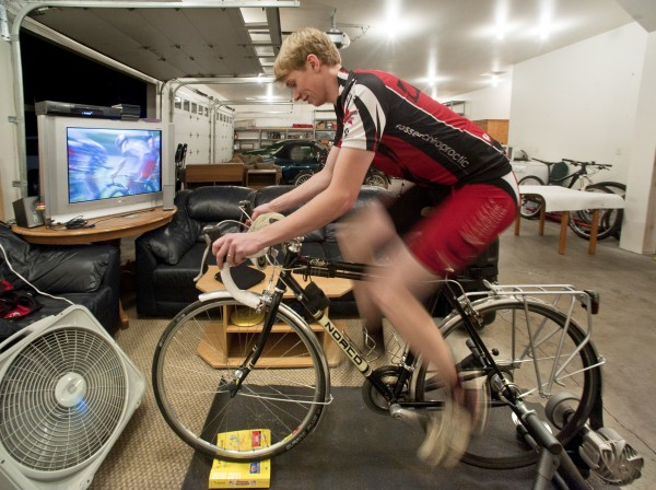 Luke Brechwald has a bike clamped into a bike trainer in the garage of his Lacey, Wash., home. There, he watches DVDs as a box fan blows, a phone book keeps the bike level, and a sweat mat below him keeps the carpet from smelling like a locker room.