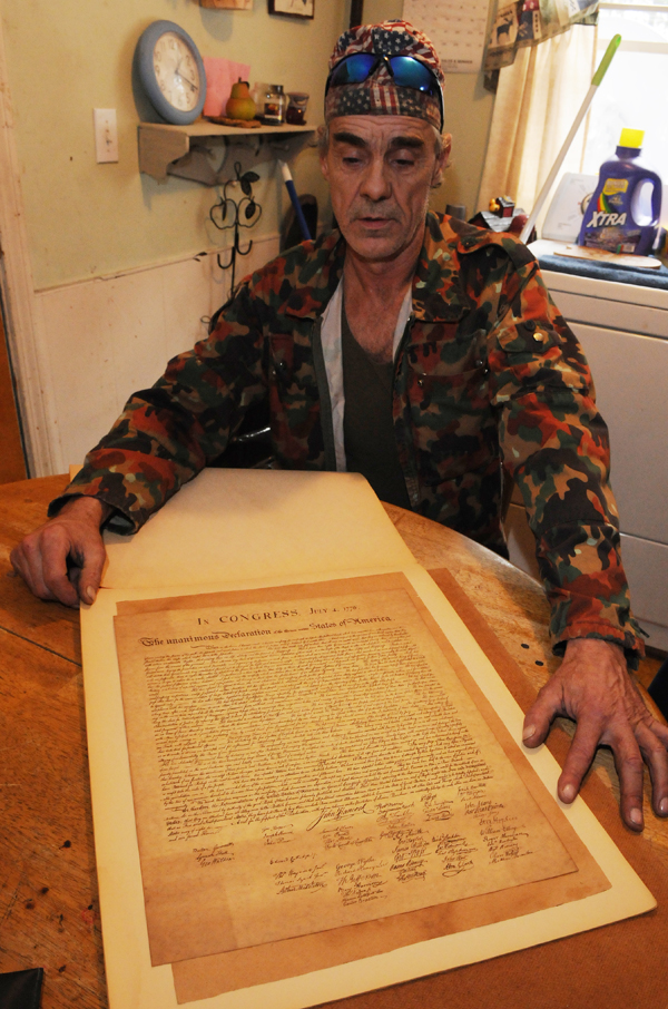 Roger Sanborn of Greenbush displays a copy of the Declaration of Independence at his brother-inlaws home on Friday, Dec. 9, 2011. Sanborn found the document in the back of a framed picture he picked from the trash 20 years ago.