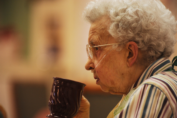 Frances Hudson takes a sip during lunch at the Phillip-Strickland House in Bangor on Wednesday, Dec. 7, 2011. Hudson, along with thousands in her situation, will be affected adversely if Gov. LePage's DHHS budget cuts at implemented.