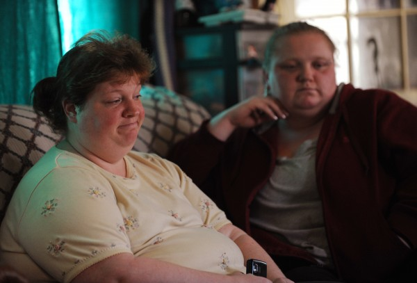 Stephanie Boutilier (left), former girlfriend of Udo Schneider, sits with her sister Wendy Hunter as they discuss the life of their friend, who police say was shot and killed by Michael Curtis on Tuesday. &quotHe was definitely a family man,&quot said Boutilier.
