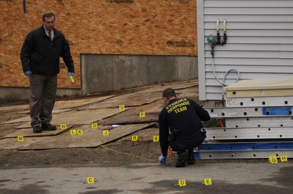 Maine State Police Trooper David Yankowski (left) and another member of the Evidence Response Team investigate the scene of a shooting in back of the Hilltop Manor in Dover-Foxcroft on Tuesday, Nov. 29, 2011. Michael Curtis of Sangerville shot and killed maintence worker Udo Schneider, also of Sangervile, at that location.