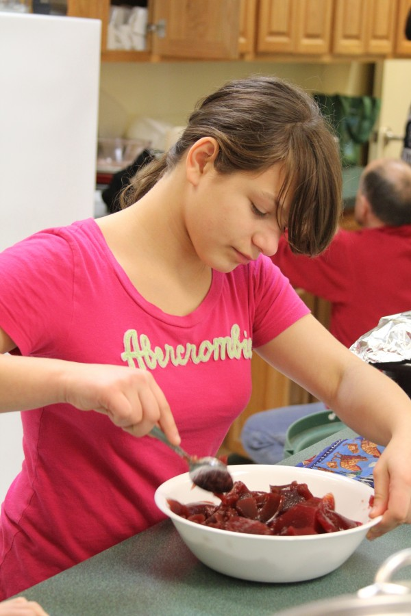 Kate Kelley, 13, of St. George helped chop up canned cranberry sauce for the town's monthly senior lunch.