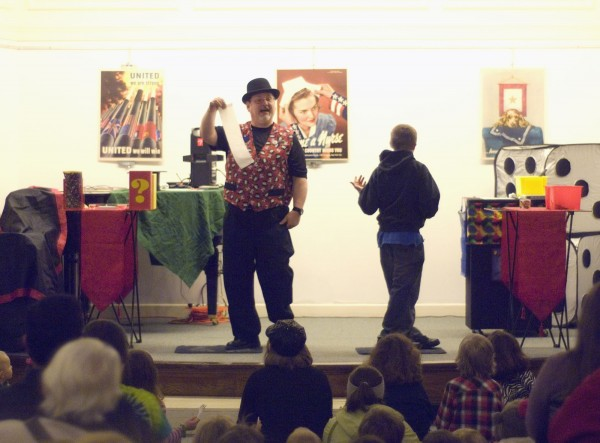 Magician Danny Baker performs to a standing-room only crowd at the Bangor Public Library as part of New Year's Eve festivities in Bangor.