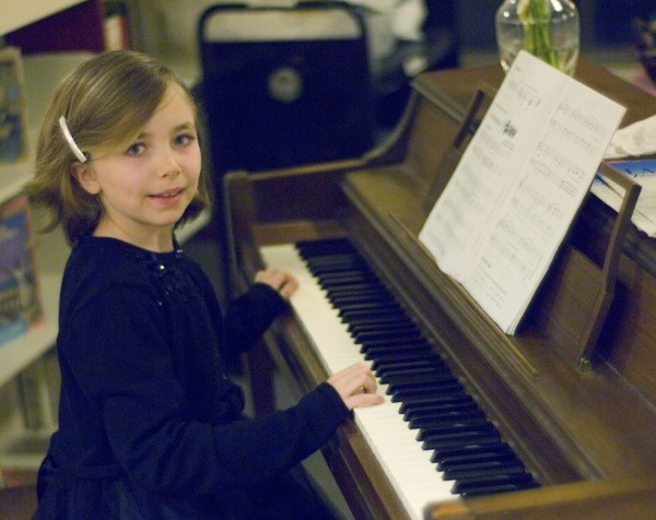 Mary Rush performed on the piano for visitors to the Bangor Public Library on New Year's Eve as part of festivities.