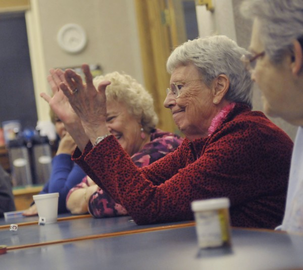 Ella Thomas gives the dice a toss in a game of Left, Right, Center with friends at the Hammond Street Senior Center on Saturday.