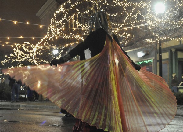 Street performers with AO Arts/ House of Paradigm/ Casual Arcane display their costumes in West Market Square as part of New Year's Eve festivities.