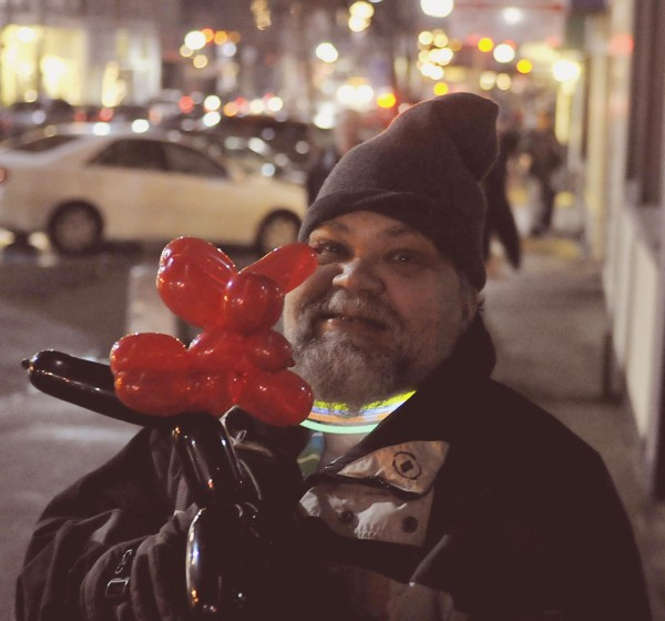 This Bangorean proudly displays his balloon creation in celebration of New Year's Eve in downtown Bangor.