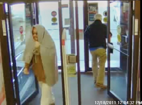 Security camera footage of the suspect entering the building.
