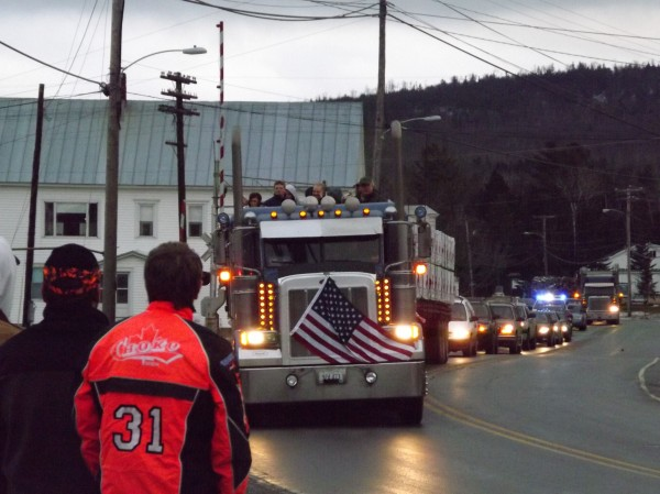 A tractor-trailer carrying Army Sgt. Timothy Gilboe and his family travel on Main Street in Jackman during a parade in his honor on Thursday afternoon. Gilboe was being celebrated by his hometown for receiving the Silver Star Medal for his actions in Afghanistan earlier this year.