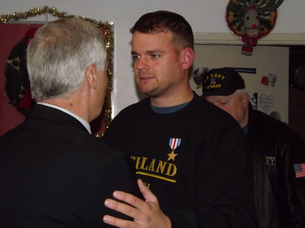 Army Sgt. Timothy Gilboe greets Rep. Mike Michaud during a reception at Forest Hills Consolidated School in Jackman on Thursday afternoon. Gilboe was being honored by his hometown for receiving the Silver Star Medal for his actions in Afghanistan earlier this year.