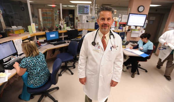 "Dr. Charles Pattavina stands amid the St. Joseph emergency department in Bangor on Friday, Dec. 23, 2011. Staff at the ER said Saturday and Sunday are usually busy times with holiday-related injuries including cooking burns and cuts due to people trying to remove gifts from thick plastic packaging. ""&quotWe definitely see people who cut themselves with a kitchen knife or a glass,&quot said Dr. Pattavina."