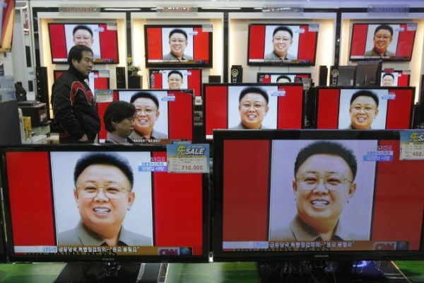 South Koreans watch a news reporting about the death of North Korean leader Kim Jong Il on TV screens at the Yongsan Electronic shop in Seoul, South Korea, Monday, Dec. 19, 2011. Kim Jong Il's death after 17 years as leader was announced Monday by state television two days after he died. He was 69.