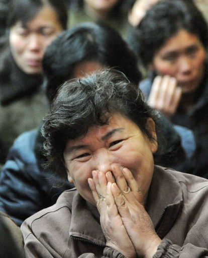 A North Korean woman cries after learning death of the country's leader Kim Jong Il on Monday, Dec. 19, 2011 in Pyongyang, North Korea. Kim died on Saturday, Dec. 17, North Korean state media announced Monday.