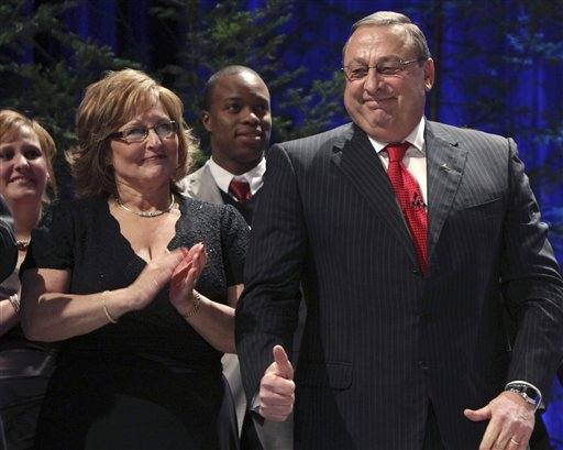Gov. Paul LePage, with his wife, Ann LePage, gives a thumbs-up while being introduced as Maine's next governor during his inauguration in Augusta, Maine, on Jan. 5, 2011.