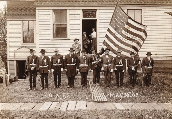 An empty right sleeve identifies Ira Gardner as the second man from the left when members of the Edwin S. Rogers Post, Grand Army of the Republic, formed up in Patten on May 30, 1908.