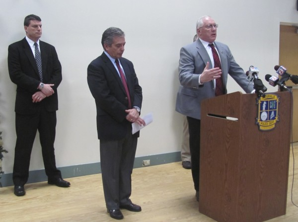 Waterville Police Chief Joseph Massey (right) addresses reporters on Monday, Dec. 26, 2011, on the status of the investigation into the disappearance of Waterville toddler Ayla Reynolds. In the center is Waterville-area attorney John Nale, who with other business owners has offered a $30,000 reward for information that leads to the discovery of Ayla's whereabouts.