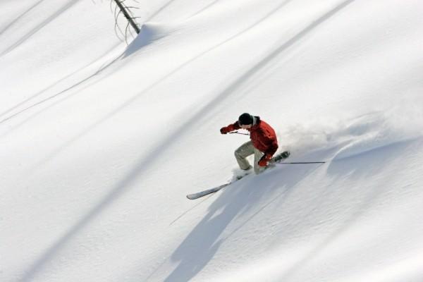 A Telemark skier slices through luscious powder off Banner Ridge north of Idaho City, Idaho.