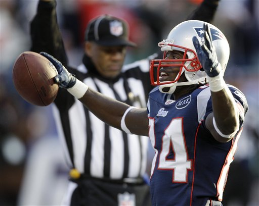 New England Patriots wide receiver Deion Branch (84) celebrates in the end zone after his touchdown against the Miami Dolphins during the third quarter at Gillette Stadium in Foxborough, Mass., Saturday, Dec. 24, 2011.