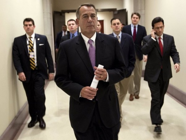 Speaker of the House Rep. John Boehner, R-Ohio, walks to a news conference on the payroll tax cut with House Majority Leader Rep. Eric Cantor, R-Va., right, on Capitol Hill on Thursday, Dec. 22, 2011 in Washington.