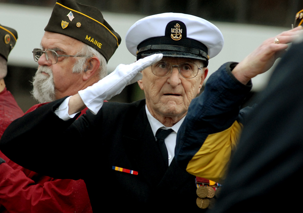 Pearl Harbor survivor Robert Coles, 87, of Machias salutes the flag as the Bangor High School band plays the national anthem during a Pearl Harbor remembrance ceremony on the Kenduskeag walking bridge on Wednesday, Dec. 7, 2011. Coles was a chief radio man in the U.S. Navy and was two weeks shy of his 18th birthday the day Pearl Harbor was bombed. Coles will turn 88 on December 21, 2011.