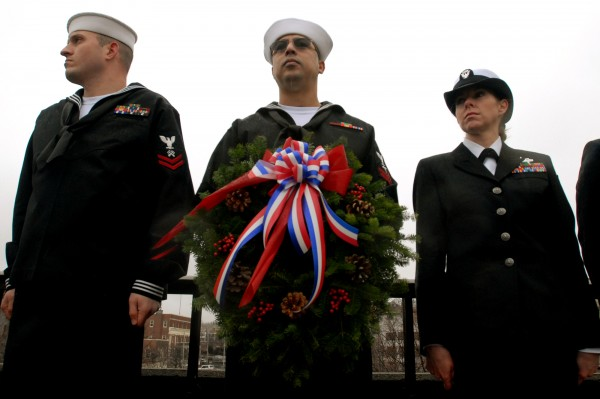 LS2 Job Johnson, HM2 Sam Elgbouri, and petty officer Rachel Whitcomb (left) wait for the ceremonial tossing of the wreath into the Kenduskeag Stream during the Pearl Harbor rememberance on Wednesday, Dec. 7, 2011.