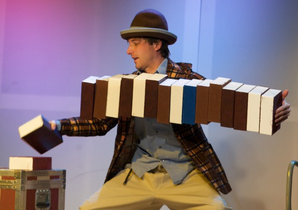 Comedian Daniel Forlano adds another box to the end of a horizontal stack in Acorn Productions' annual Christmas week festival of physical comedy, Phyzgig, at Space Gallery in Portland on Tuesday. The festival features a dozen shows running through the end of the week