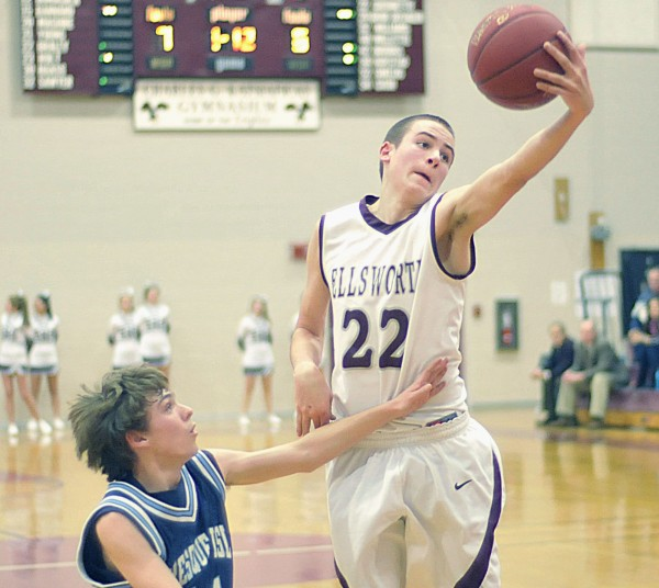 Ellsworth boy's basketball player Brandon Braley (22) snags a pass over the reach of Presque-Isle's Jonah Stephenson (14) in the first half of their game in Ellsworth Thursday, Dec. 29, 2011.