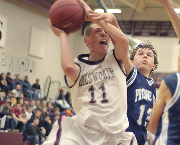 Ellsworth boy's basketball player Josh Bean (11) gets fouled by Presque-Isle's Wilder York (12) in the first half of their game in Ellsworth Thursday Dec. 29, 2011.