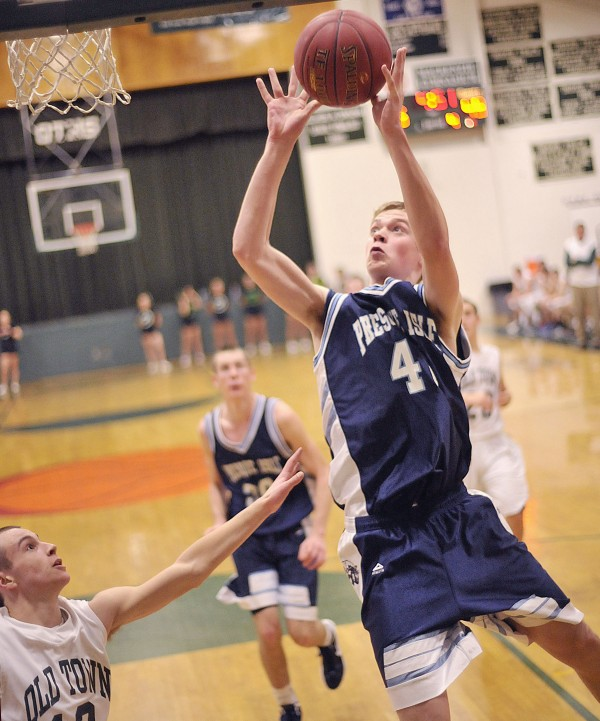 Presque Isle boy's basketball team player Tyler Brooks (42) puts up a shot off the glass over Old Town's Cameron Archer (12) in the second half of their game in Old Town, Saturday Dec. 17, 2011.