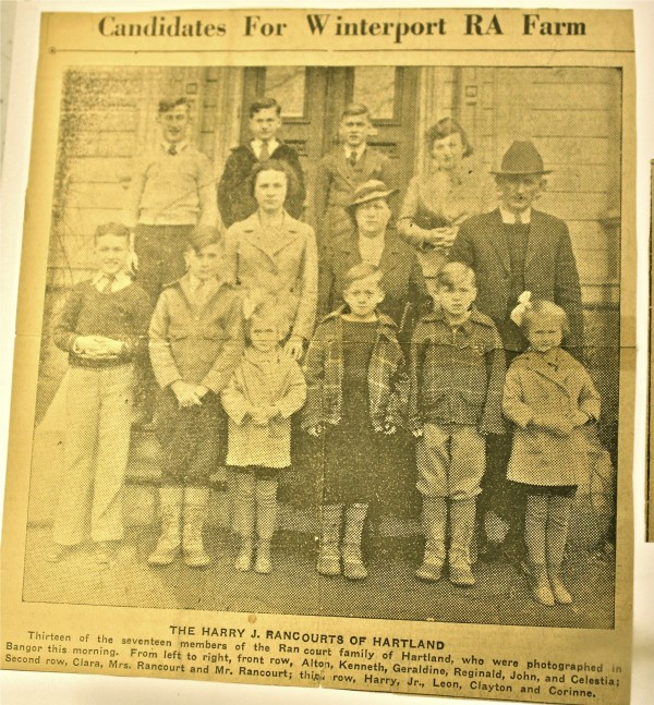 A Bangor Daily News photo of the family of Harry and Alice Rancourt taken in 1937. The caption reads: &quotThirteen of the seventeen members of the Rancourt family of Harland, who were photographed in Bangor this morning. From left to right, front row, Alton, Kenneth, Geraldine, Reginald, John and Celestia; Second row, Clara, Mrs. Rancourt and Mr. Rancourt; third row, Henry, Jr., Leon, Clayton and Corinne.&quot
