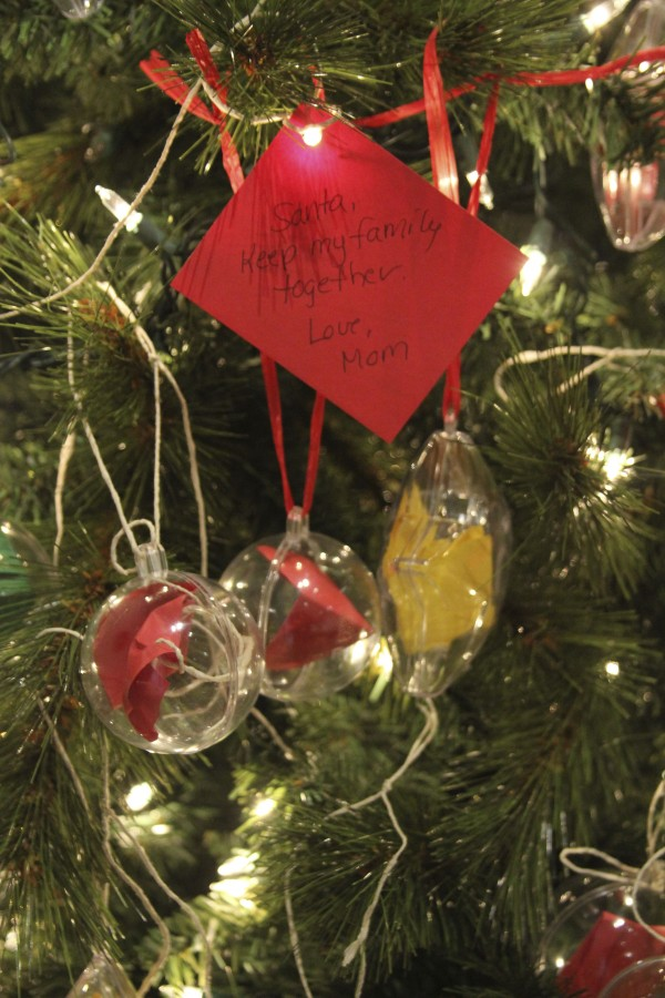 One woman's compelling plea hangs in front on the Wish Tree at the Farnsworth Art Museum in Rockland on Thursday, Dec. 8, 2011. Among other holiday wishes are requests for peace, toys and kindness. Anyone can add a wish to the tree.