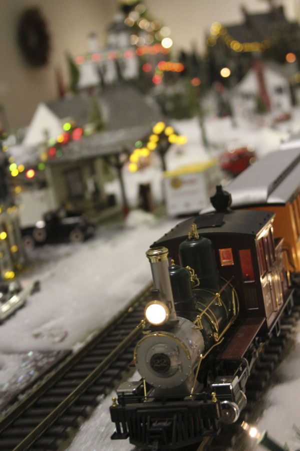 A model train chugged by midcoast landmarks on Thursday, Dec. 8, 2011 as part of the Share the Wonder exhibit at the Farnsworth Art Museum in Rockland. The model trains even pass by the Rockland Breakwater Lighthouse.