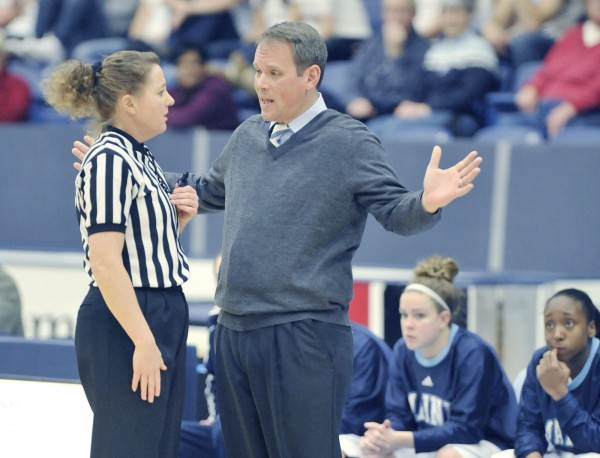 Maine women's Basketball coach Richard Barron asks for a referee's help in deciphering a call against Maine in the first half of their game in Orono Thursday Dec. 29, 2011.