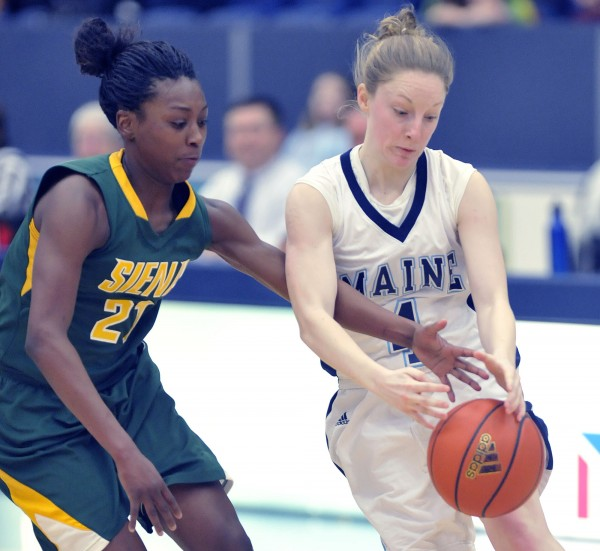 Siena women's basketball player Tehresa Coles (21) gets a hand in the way of the inbound pass to Miane player Courtney Anderson (4) in the first half of their game in Orono Thursday, Dec. 29,  2011.