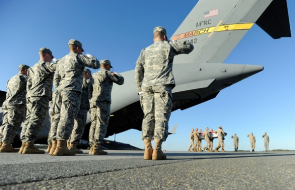 A Marine carry team at Dover Air Force Base, Del., moves a transfer case containing the remains of a Marine who died in October while conducting combat operations in Helmand province, Afghanistan.