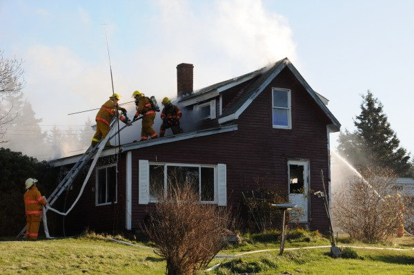 Firefighters from Swans Island, Southwest Harbor and Tremont battled a house fire on the island on Monday, Dec. 12, 2011. Fire crews from Southwest Harbor and Tremont had to take a ferry across the bay to help local crews extinguish the blaze, which destroyed the home located on Stanley Point Road.