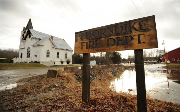 The Thorndike Conregational Church stands next to the Thorndike Fire Department. The Church burned early Wednesday monring and was reported by a passerby. Firefighters responded and battled the blaze for several hours. Fire Chief Peter Quimby says the weight of the bell in the tower was a concern for a while.