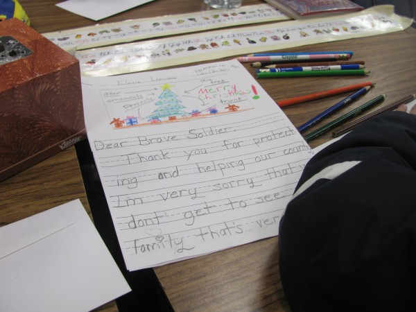 Third-grade students at Woodside Elementary School in Topsham spent the morning of Monday, Dec. 19, 2011, writing letters to U.S. military personnel who will be stationed in Afghanistan for Christmas.