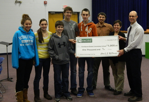 Science students at the Van Buren District Secondary School brought home a $1,000 prize for their video entry in the S.W. Cole, Inc. Dig Into Science contest. Receiving their award are students Chantal Rioux (from left), Parise Rossignol, Nick Lajoie, Marc Lajoie and Forrest Bouchard with their teacher Steve Giangiordano and S.W. Cole engineers Sara Ashley and Chad McPherson.