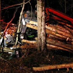 'He's very lucky': Logging truck driver suffers minor injuries after truck rolls over, crushes cab