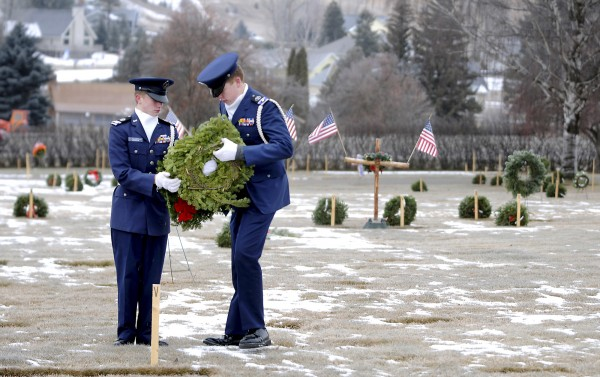 Cadet Cpt. Tor Jackola and Cadet 2nd Lt. Chris Rodwick of the U.S. Civil Air Patrol Flathead Composite Squadron MT053 prepare to lay a wreath at the grave of a veteran Friday morning at Glacier Memorial Gardens cemetery north of Kalispell, Mont. Earlier this month, thieves stole 170 wreaths that had been placed at the cemetery as part of the national Wreaths Across America project based in the Down East Maine community of Harrington. Worcester Wreath founder Morrill Worcester, who started the project 20 years ago, contributed an additional 100 wreaths to help replace those snatched from the Montana graves. Those donated wreaths, among others, were placed on graves during a second ceremony Friday, Dec. 23.